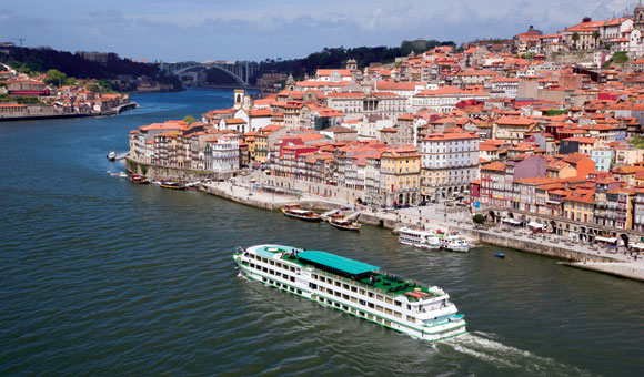 Visit historic towns and cruise past terraced vineyards along the River Douro